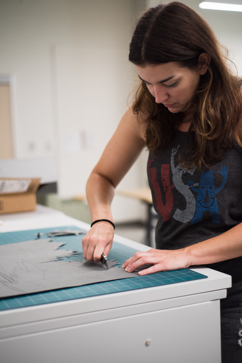 Hard at work: Lydia prepared cut-outs to layer for one of her projects