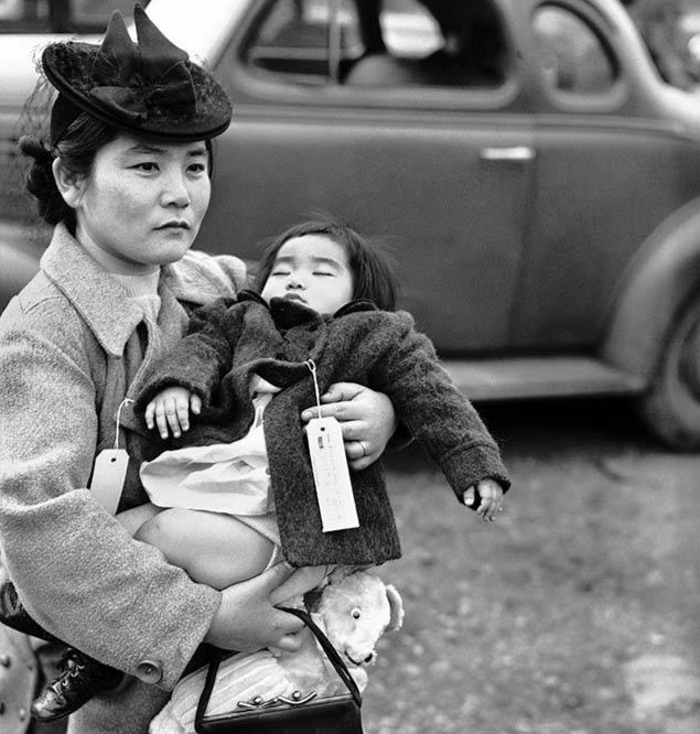 Fumiko Hayashida holds her daughter as they prepare to leave home to be imprisoned. Museum of History & Industry, Seattle Post-Intelligencer Photograph Collection, PI28050.
