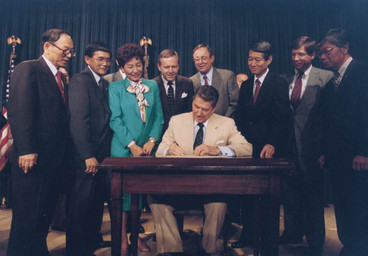 Ronald_Reagan_signing_Japanese_reparatio