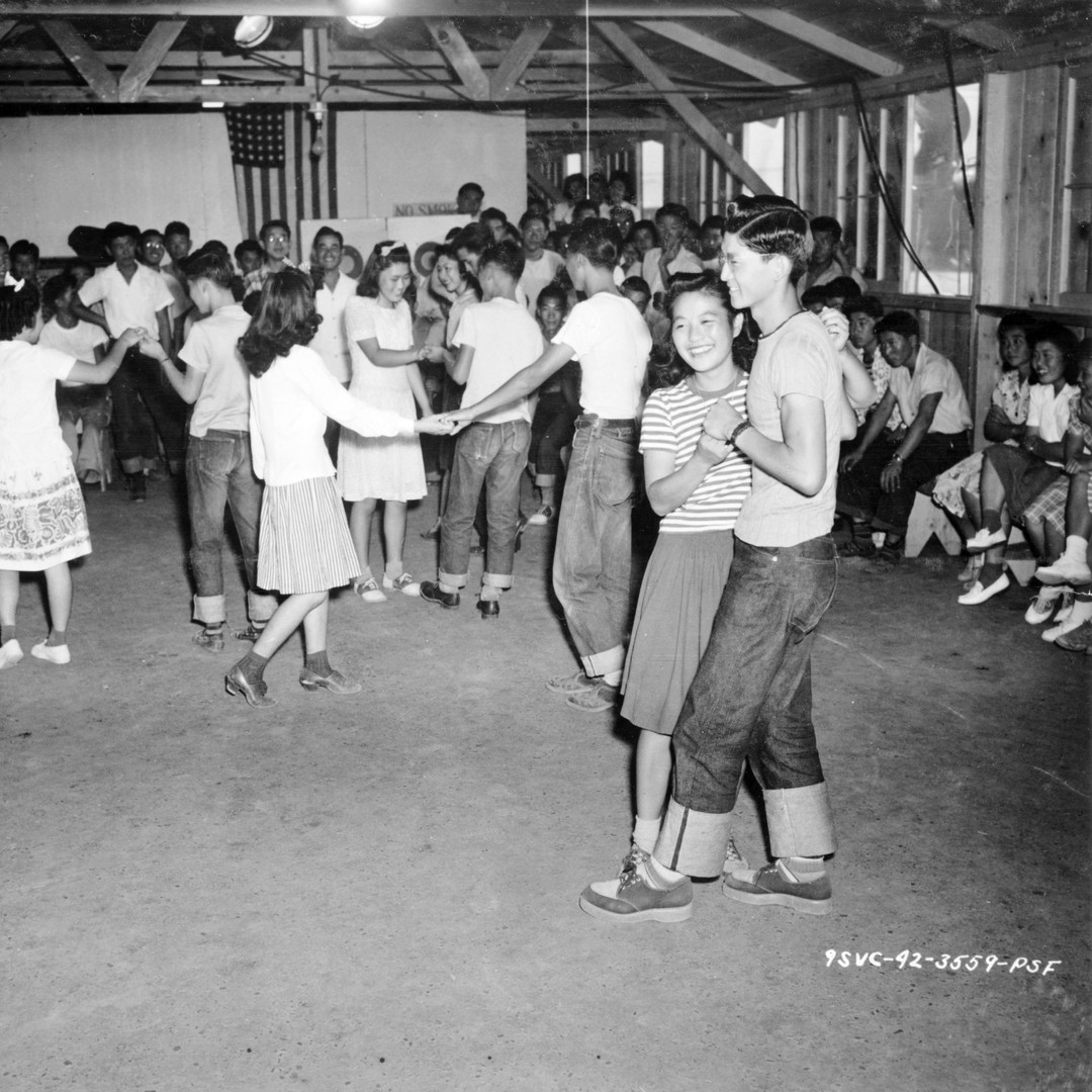 Younger evacuees use dancing as a diversion at the Assembly Center in Fresno, CA.