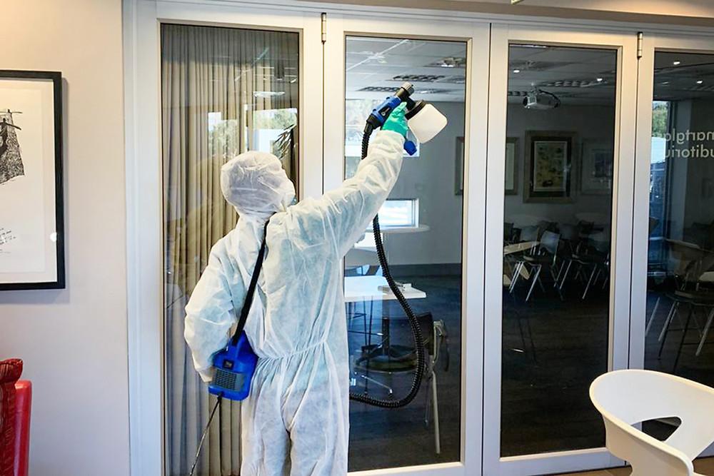 IWESCO employee using a thermal fogging machine