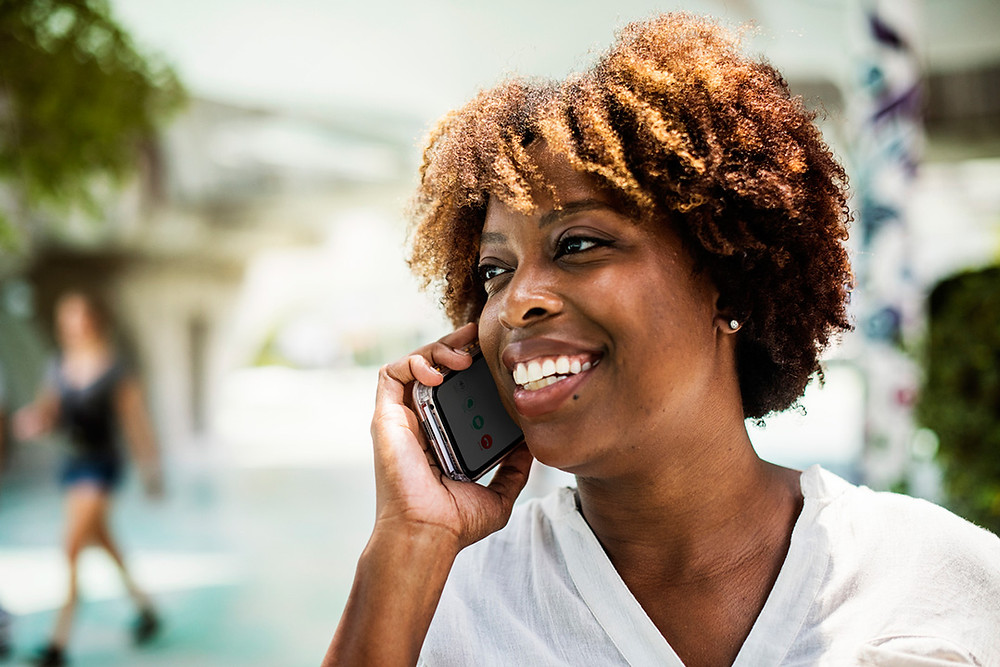 Black female on cell phone for B-BBEE