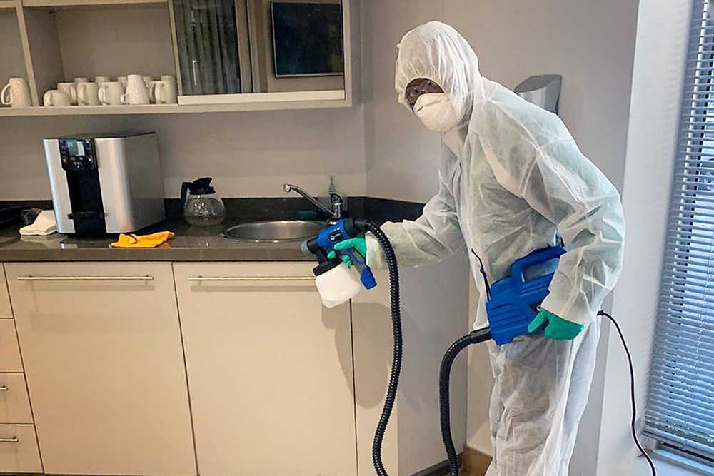 Man fogging in kitchen industry