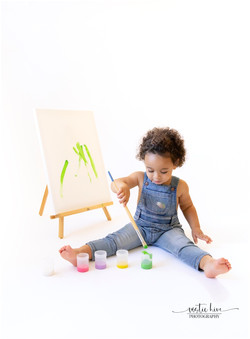 paint session with 2 year old on white b