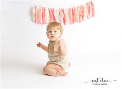1 year old girl kneeling on white backgr