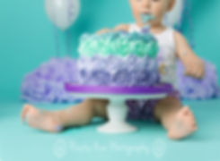 PIcture of girl cake smash on turquoise