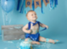 One year old boy in cake smash session