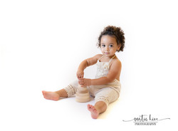 2 year old girl on white background play