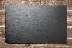 Slate%20blackboard%20on%20wooden%20backg