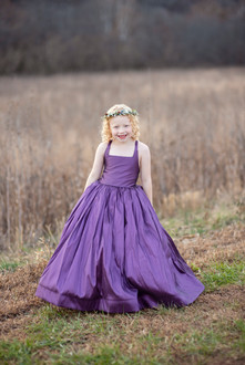 girl in designer gown in meadow