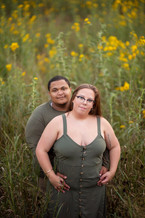 engaged couple in flowers