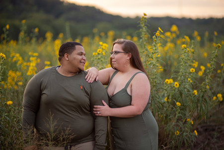 engaged couple in flower meadow