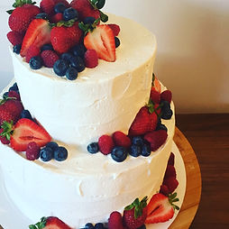 Berrie and whipped cream wedding cake