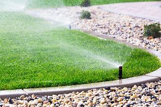 Automatic sprinklers watering grass.jpg