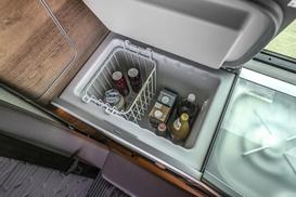The fridge in a VW California Ocean with bottles in