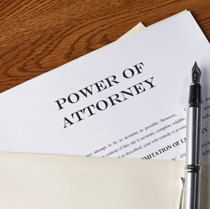 A power of attorney document with a fountain pen on top