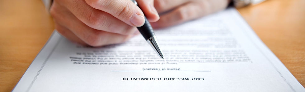 Person signing last will and testament with a black pen