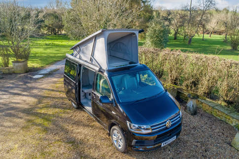 VW California Camper with Roof Up In Countryside