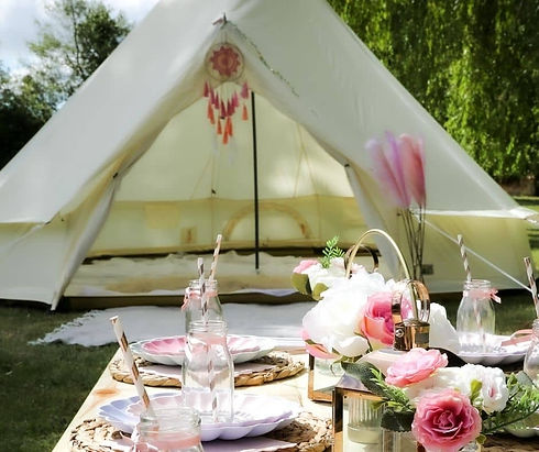 Picnic Infront of A Bell Tent with pink flowers
