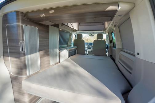 The bed and wardrobe  in a VW California Ocean