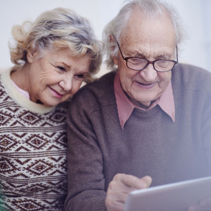 Elderly couple looking at a computer tablet
