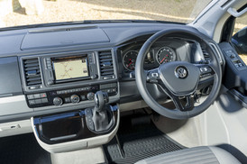 The drivers seat, steering wheel and navigation in a VW California Ocean