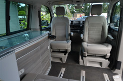 The Interior of a VW California Ocean with Cockpit Seats Facing Inwards & Kitchen