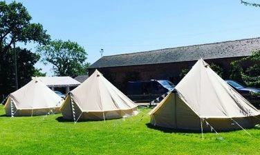 Bell Tents On A Green Field