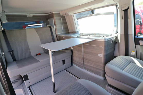 The dining table and chairs in a VW California Ocean 6.1