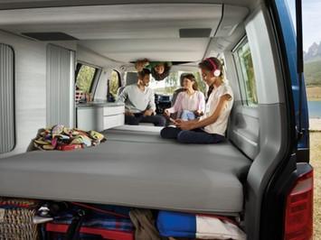 Children Reading Inside A  VW California Ocean