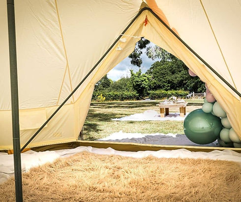 Looking Out Of A Bell Tent at a table and balloons