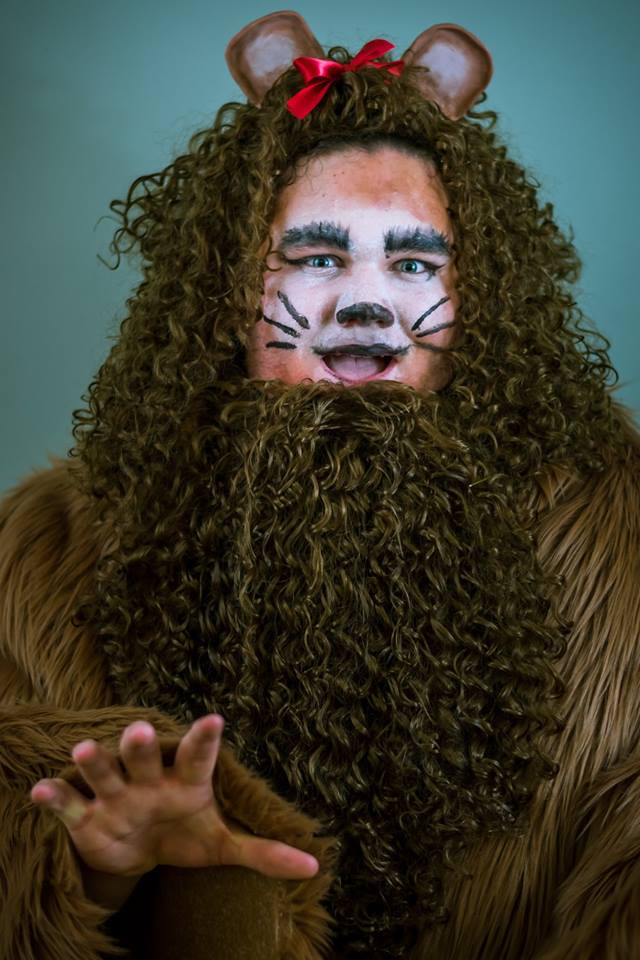 Grant Huneycutt as the Cowardly Lion