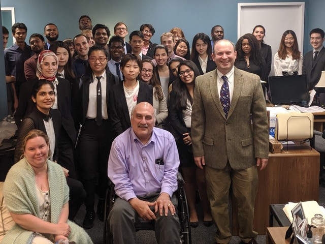 group of university of maryland graduate students standing with found of UserWorks, a usability lab in College Park, MD