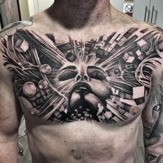surreal-tattoo-chest-tattoos
