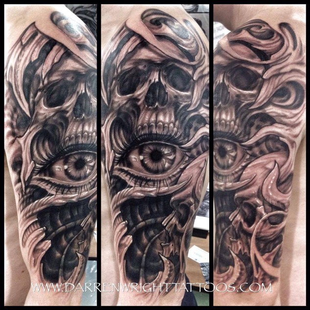 freehand-skull-eye-biomech-tattoo
