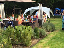 BBQ guests eating al fresco