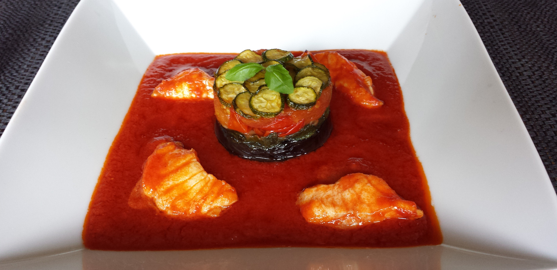 Aubergine Gateau with Monkfish in Fresh Tomato Sauce