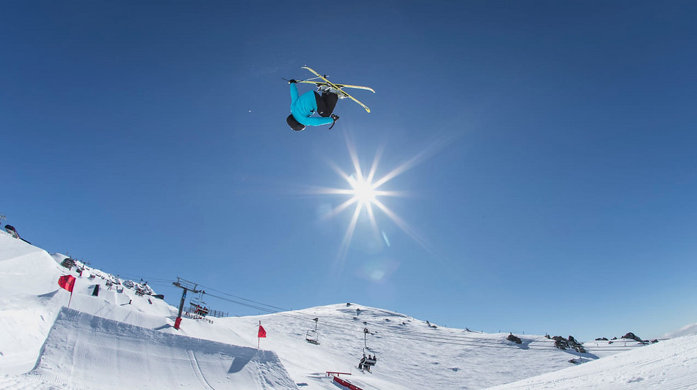 skier on slopestyle course