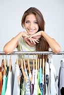 Woman with hangers in a T-shirt printing company