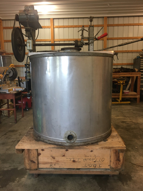 I extract my honey using a 33-frame Kelley extractor from the 1970s. It is an old extractor but gets the job done. It was also a lot cheaper than a new machine by a couple thousand dollars. The frames are aligned in the barrel in a circular pattern that resembles spokes on a bike tire. The frame spins and acts as a centrifuge which flings the honey from the combs. The honey runs down the side and out the front. Each spin yields about five gallons of honey. The honey is filtered to remove large debris but leavesbehind pollen. It is poured off into five gallon buckets and stored for sale.