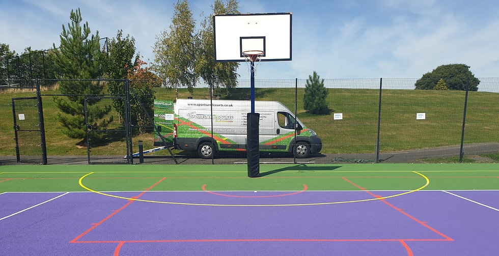 Sports and courts van in front of sports surface