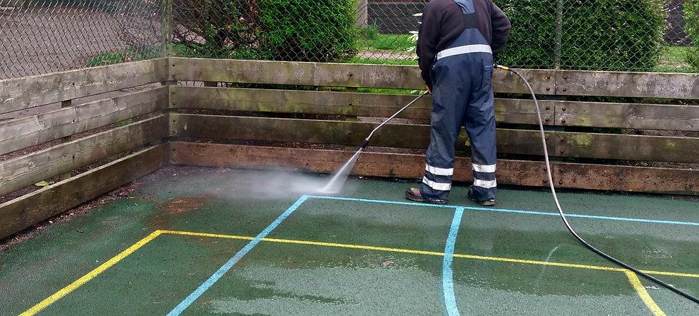 Man spraying moss remover