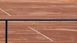 Tennis-Court-Through-the-Fence