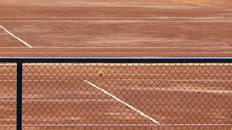 Tennis Court Through the Fence