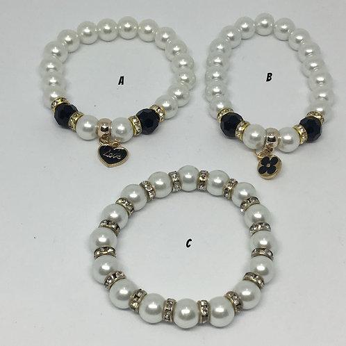 Pulseras elàsticas de perlas y dijes