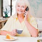 happy-smiling-elderly-woman-talking-on-p