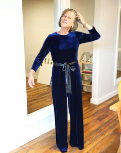 Sara Campbell wears her stretch velvet jumpsuit in navy.
