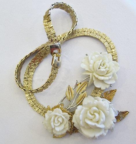 Designer necklace featuring carved roses, goldtone flat link setting.