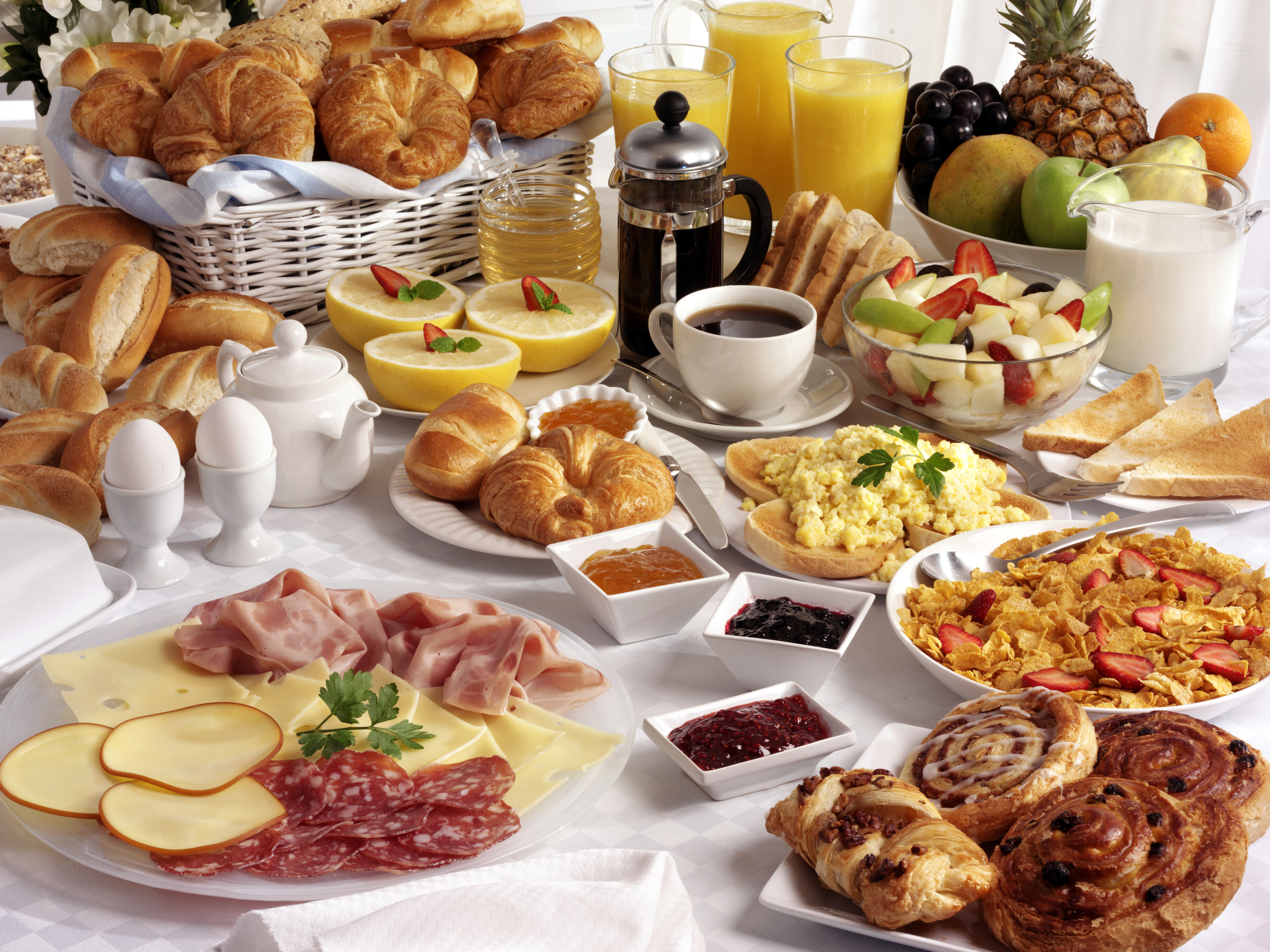 BREAKFAST TABLE FILLED WITH ASSORTED FOO