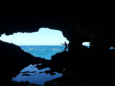 Woman silhouette in a Sea Cave